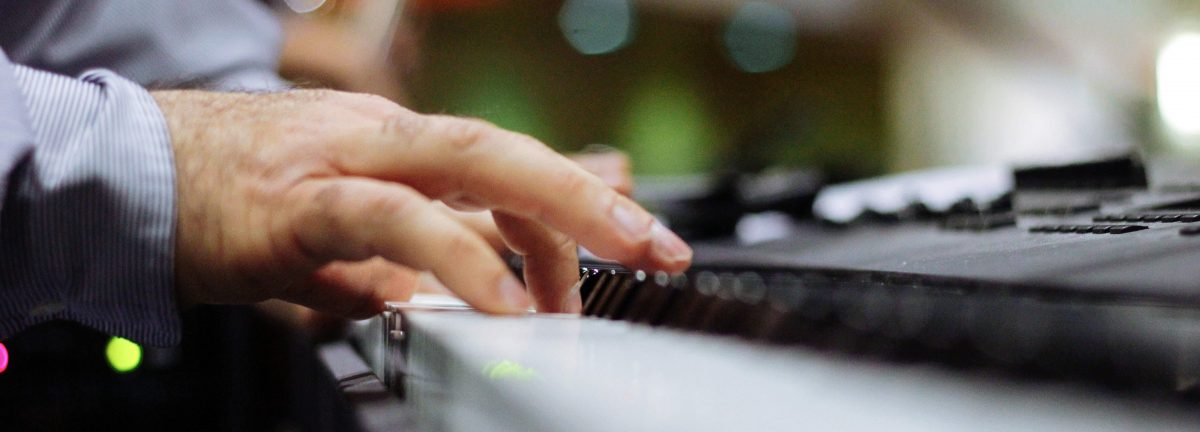 Photo: closeup of hands playing piano